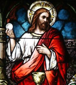 Christ holding Communion host